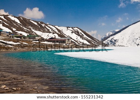 Village Gokyo and lake Dudh Pokhari  at a sunny day. Himalayas. Nepal - stock photo