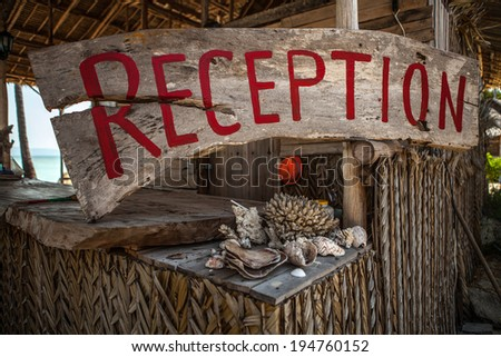 Village hotel. reception sign. - stock photo