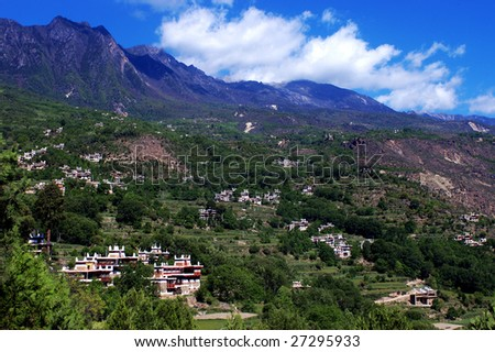 Village in mountains under the blue sky and white cloud,Danba,Ganzi,Sichuan,China - stock photo