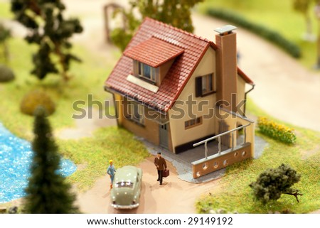 village miniature with house and lake - stock photo