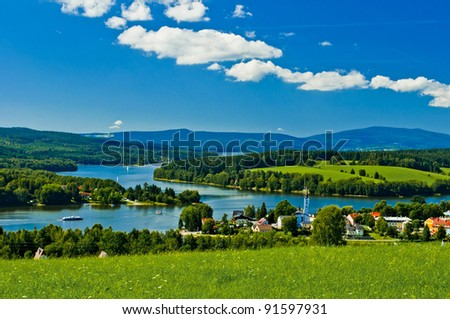 village near lake - stock photo
