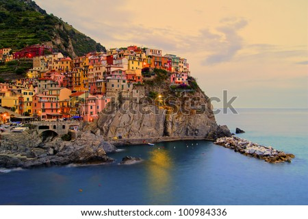 Village of Manarola, Italy on the Cinque Terre coast at sunset - stock photo
