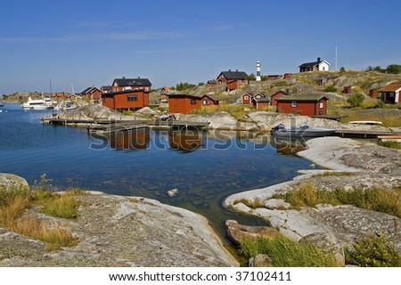 Village of red houses on an island