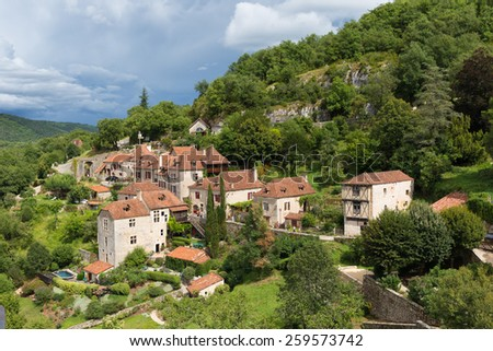 Village of Saint Circ Lapopie in France on a cloudy day - stock photo