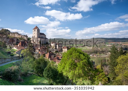 Village of St Cirq La Poppie with blue sky and white clouds Lot France