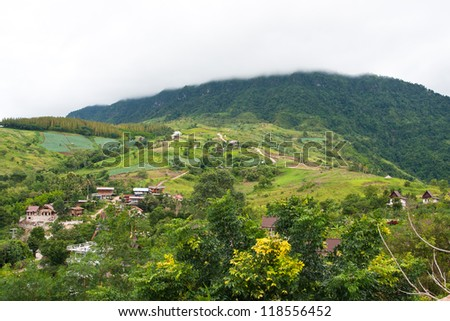 Village on hill with fog in thailand