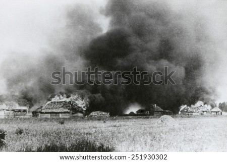 Village on the Densa River in flames during the Nazi invasion of the Soviet Union. August 1941, World War 2. - stock photo