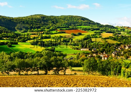 Village Surrounded by Pasture and Plowed Fields in the French Limousen - stock photo