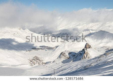 Villages of Tignes le Lac and Val Claret are visible in the valley between mountains - stock photo