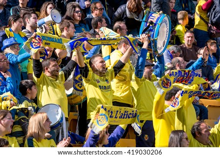 VILLARREAL, SPAIN - MAR 20: Fans at the La Liga match between Villarreal CF and FC Barcelona at El Madrigal Stadium on March 20, 2016 in Villarreal, Spain. - stock photo
