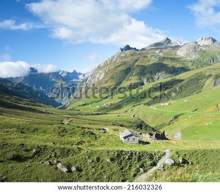 VILLE DES GLACIERS, FRANCE - AUGUST 27: Composite of Glaciers Village with chalets. The region is a stage at the Mont Blanc tour, which crosses three countries. August 27, 2014 in Ville des Glaciers. - stock photo