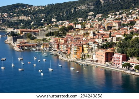 Villefranche sur Mer with its historic citadel is situated between Nice city and Monaco. The bay is a deep natural harbor in the mediterranean sea nd provides safe anchorage for cruise ships. - stock photo