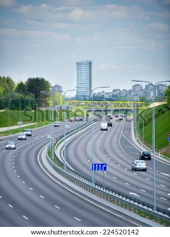 VILNIUS - APR 29: Highway (motorway) traffic on Apr. 29, 2014 in Vilnius, Lithuania. A newly constructed street connect IXB transport corridor with Vilnius International Airport. - stock photo