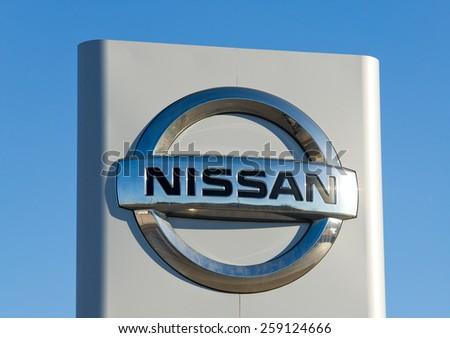 VILNIUS - FEB 17: Nissan dealership logo on Feb. 17, 2015, Vilnius, Lithuania. Nissan Motor Corporation is a Japanese multinational automobile manufacturer headquartered in Nishi-ku, Yokohama, Japan. - stock photo