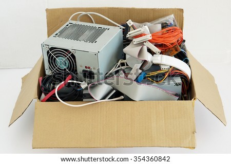 VILNIUS, LITHUANIA - AUGUST 07, 2015: Cardboard box with the old used all brands computer spare  parts  prepared for utilization. Every year the USA jumps out to 20 million old computers - stock photo