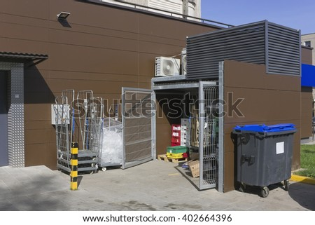 VILNIUS, LITHUANIA - AUGUST 15, 2015: Correct modern utilization and collecting garbage near Maxima  small shop. Containers,  are located and equipped in compliances with norms of the European Union.