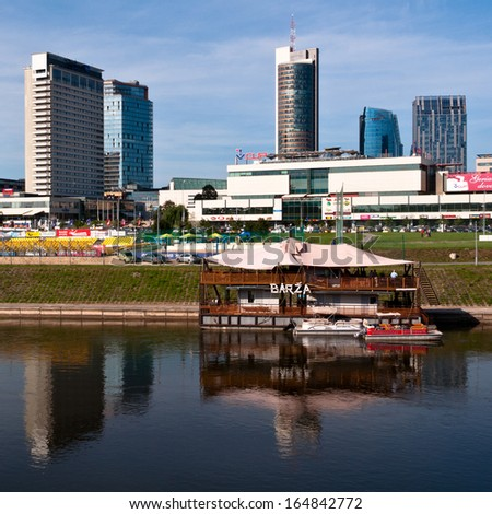 VILNIUS, LITHUANIA - AUGUST 6: New modern corporate buildings in Vilnius on August 6, 2013. Newly built business skyscrapers as seen from the other side of Neris river.