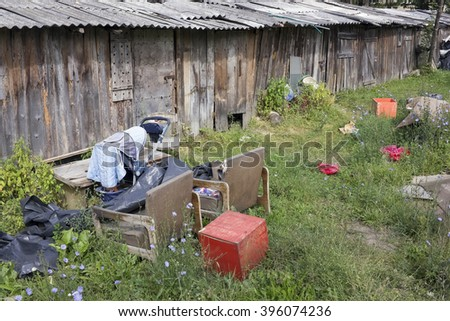 """VILNIUS, LITHUANIA - AUGUST 22, 2015: The Gipsy slums and sheds in the urban residential city area """"Pilaite"""".  In any European country Roma don't want to observe universal laws - stock photo"""