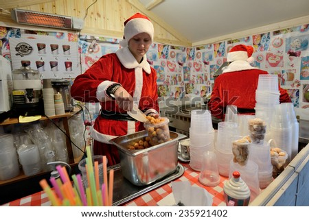 VILNIUS, LITHUANIA - DECEMBER 7: Unidentified people trade food in annual traditional Christmas fair on December 7, 2014 in Vilnius, Lithuania - stock photo
