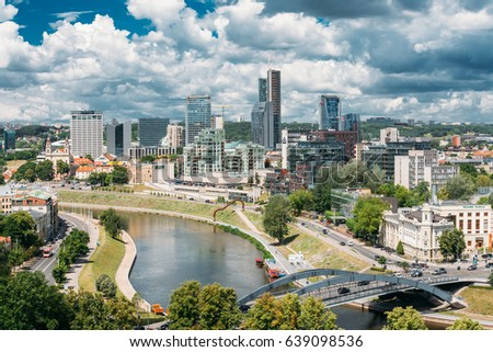 Vilnius, Lithuania  - July 5, 2016: Hanner Tower, Church Of St Raphael Archangel, Radisson Blu Hotel, Swedbank Office, City Municipality, City Style Centre Europa, Telia Lietuva, King Mindaugas Bridge