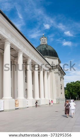 VILNIUS, LITHUANIA - JULY 19, 2015: Unidentified people walk on Cathedral Square near Cathedral of St. Stanislaus and St. Vladislav, Chapel of St. Casimir