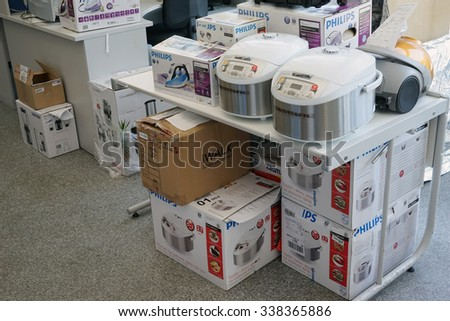 VILNIUS, LITHUANIA - JULY 03, 2015: Working room of small service center for repair of Philips brand  home  electronics. Philips is the largest global manufacturer of household appliances - stock photo
