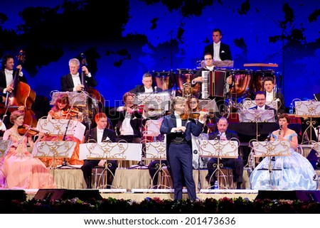 VILNIUS, LITHUANIA - JUN 3: ANDRE RIEU together with his 60-piece Johann Strauss Orchestra performs on stage in Siemens Arena on June 3, 2014 in Vilnius, Lithuania. Andre Rieu is a famous Dutch violinist. - stock photo