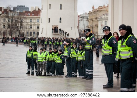 VILNIUS, LITHUANIA - MAR 11: Around 200 police officers ensured safety during the nationalist rally at Gedimino Avenue in central Vilnius on Re-Establishment of Independence Day on March 11, 2012.