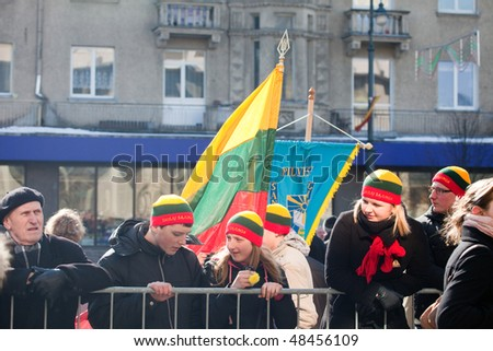 VILNIUS, LITHUANIA - MARCH 11:  People watching the ceremony of hoisting flags on 20th Anniversary of Restoration of Independence of Lithuania on Mar 11, 2010