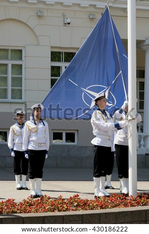 VILNIUS, LITHUANIA - MAY 29, 2016: Seamen of armed forces and navy of the Republic of Lithuania prepare for solemn raising of NATO flag near the presidential palace - stock photo