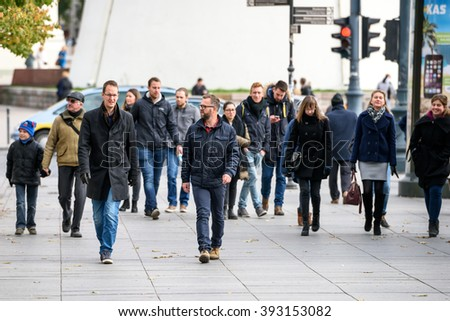VILNIUS, LITHUANIA - OCTOBER 10, 2015: People walk on Cathedral Square near Cathedral of St. Stanislaus and St. Vladislav and bell tower