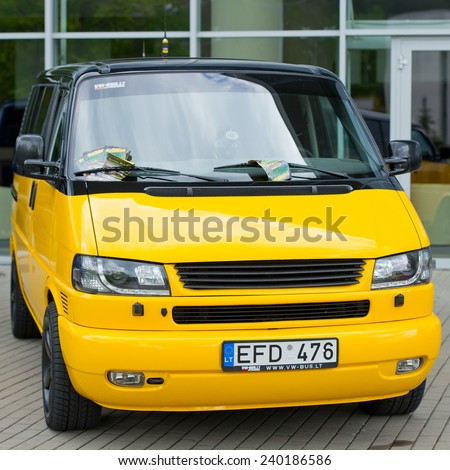 VILNIUS-MAY 9: VW Transporter-Multivan-Caravelle T4 tuning van on May 9, 2014 in Vilnius, Lithuania. The Volkswagen Transporter refers to a series of vans produced over 60 years and marketed worldwide - stock photo