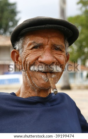 VINALES, CUBA - MARCH 19: A Cuban man smokes a cigar March 19, 2009 in Vinales, Cuba. Cubans of all ages are actively smoking cigars. All cigars production in Cuba is controlled by the government.