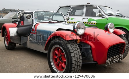 VINCENNES, FRANCE - JANUARY 6: Lotus Seven takes part in antique cars exhibition on January 6, 2013 in Vincennes, France. - stock photo