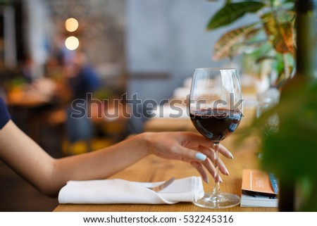 Vine glass in woman hand , rest time