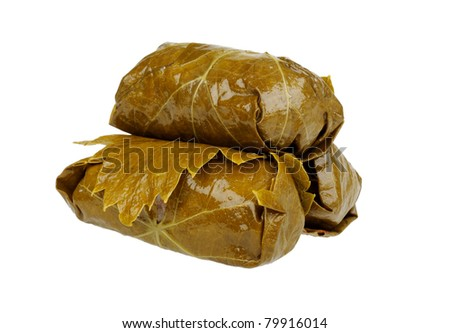 vine leaf stuffed with rice (dolmades on white) - stock photo