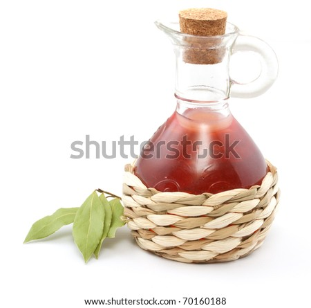 vinegar bottle and laurel leaf on the white - stock photo