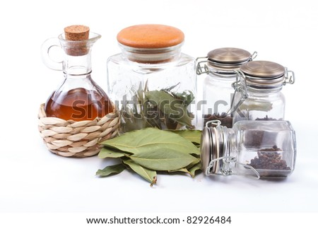 vinegar bottle, spices and laurel leaf on the white - stock photo
