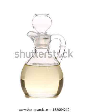 Vinegar in glass carafe. Isolated on a white background. - stock photo
