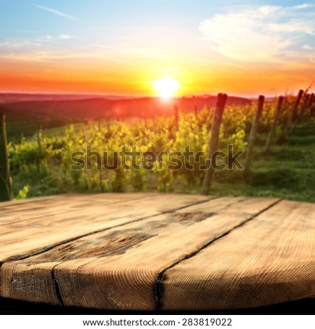 vineyard at sunset in the Chianti region in Italy and dirty table place  - stock photo