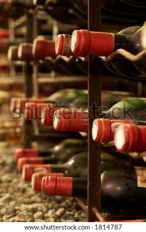 vineyard cave with old bottles - stock photo