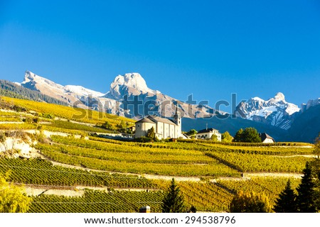 vineyards below church at Conthey, Sion region, canton Valais, Switzerland - stock photo
