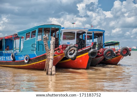 VINH LONG, VIETNAM - MARCH 6: Traditional colorful river boats on March 6, 2009 in Vinh Long. The Mekong river is a major route for transportation in Southeast Asia.