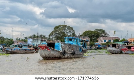 VINH LONG, VIETNAM - MARCH 7: Traditional riverboats moored at Mekong river on March 7, 2009 near Vinh Long. The Mekong river is a major route for transportation in Southeast Asia.