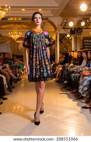 Vinnitsa, Ukraine - APRIL 28: Models walk the runway at the Dasha Furman Summer 2015 fashion show on April 28, 2015 in Vinnitsa, Ukraine - stock photo