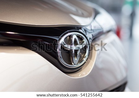 Vinnitsa, Ukraine - December 16, 2016.Toyota C-HR concept car.Front of the car,front-side, logo Toyota, showroom.Presentation of the new model Toyota car - Toyota C-HR