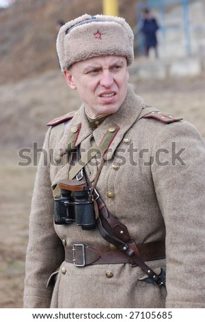 VINNITSA, UKRAINE - MAR 21: A member of history club called Red Star wears historical Soviet uniform as he participates in a WWII reenactment in Vinnitsa, Ukraine on March 21, 2009.