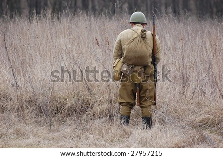 VINNITSA, UKRAINE - MAR 21: A member of history club called Red Star wears historical Soviet uniform as she participates in a WWII reenactment in Vinnitsa, Ukraine on March 21, 2009.