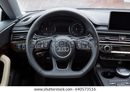 Vinnitsa, Ukraine - May 14, 2017. Audi A5 Sportback car.Front of the car, logo Audi,TFSI engine, quattro system, sportcar, luxury car,sport sedan. Presentation of the new model car- Audi A5 Sportback