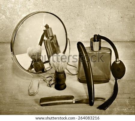 Vintage accessories for shaving. Razor and shaving brush. toning - stock photo
